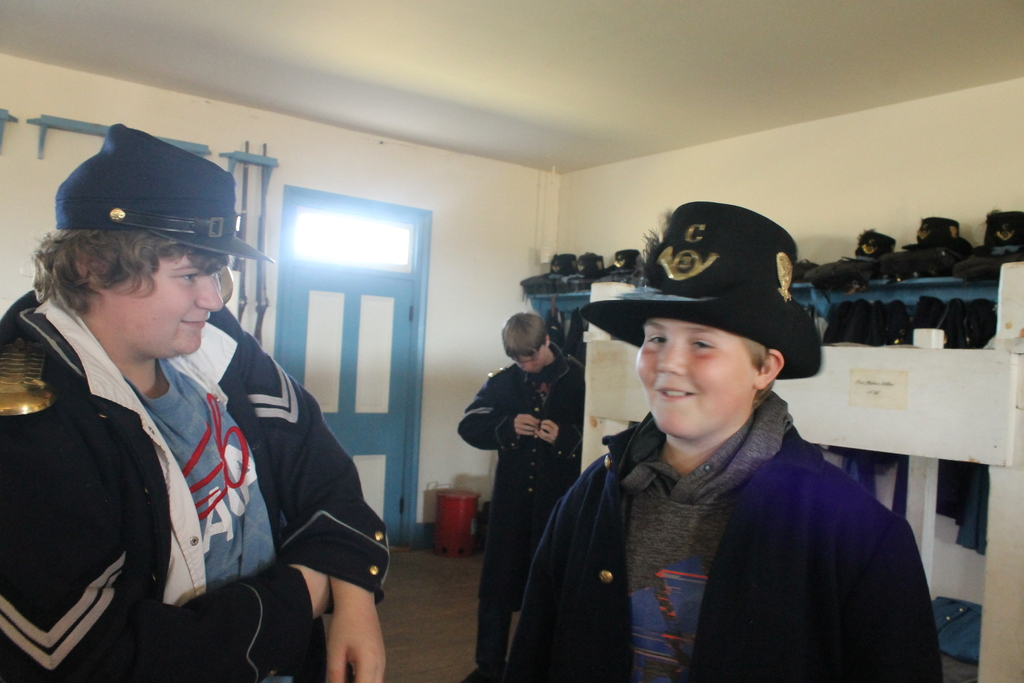 Students trying on the soldier uniforms in the barracks.