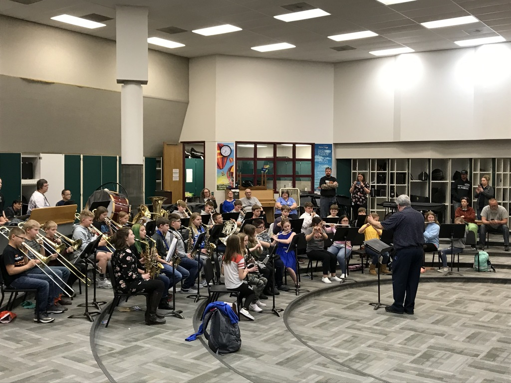 6th Grade Band in Action with supporters watching